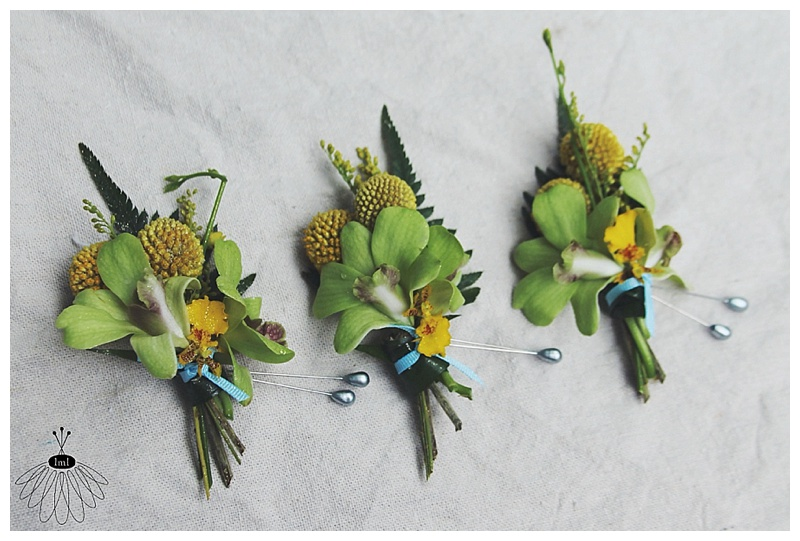 little miss lovely // yellow tropical beachy boutonnieres // seacrets wedding