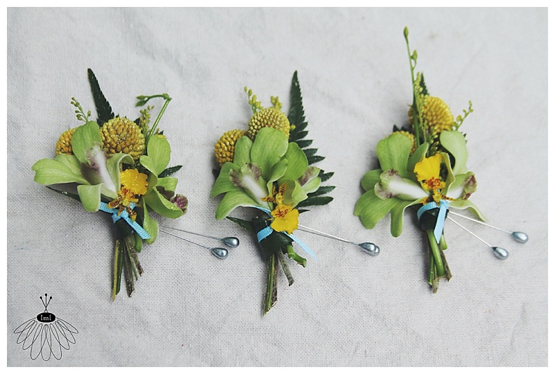 little miss lovely // tropical green and yellow orchid boutonnieres // groomsmen // ocean city, md florist