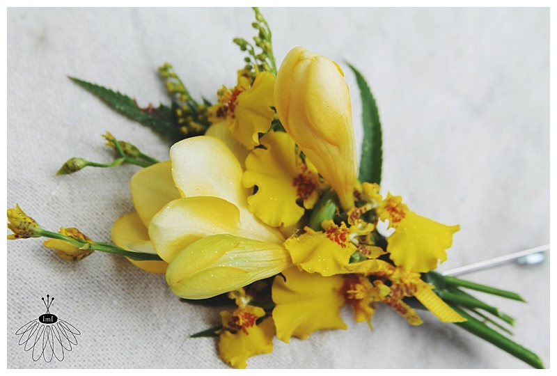 little miss lovely // wedding florist // ocean city md // tropical yellow orchid boutonniere // seacrets