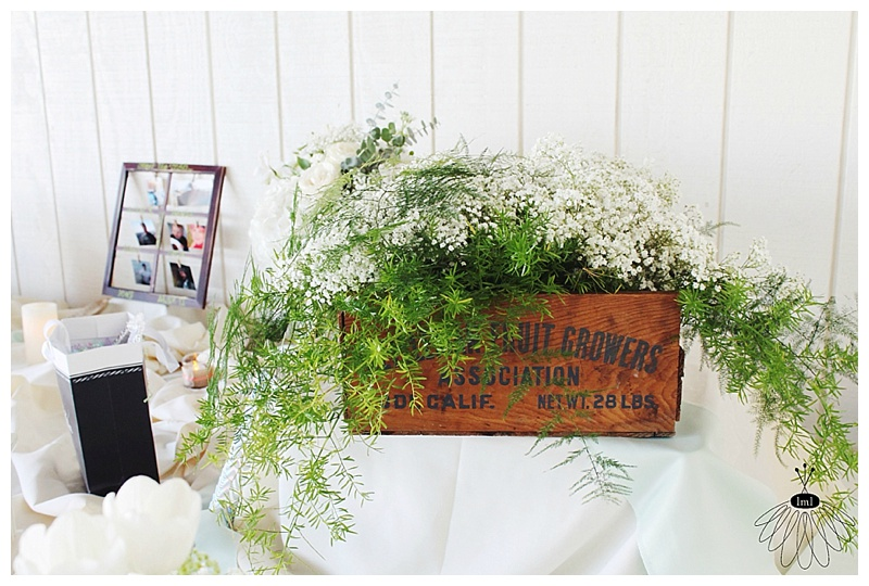 little miss lovely // ocean city md wedding florist // gift table flower arrangement // babys breath wooden crate