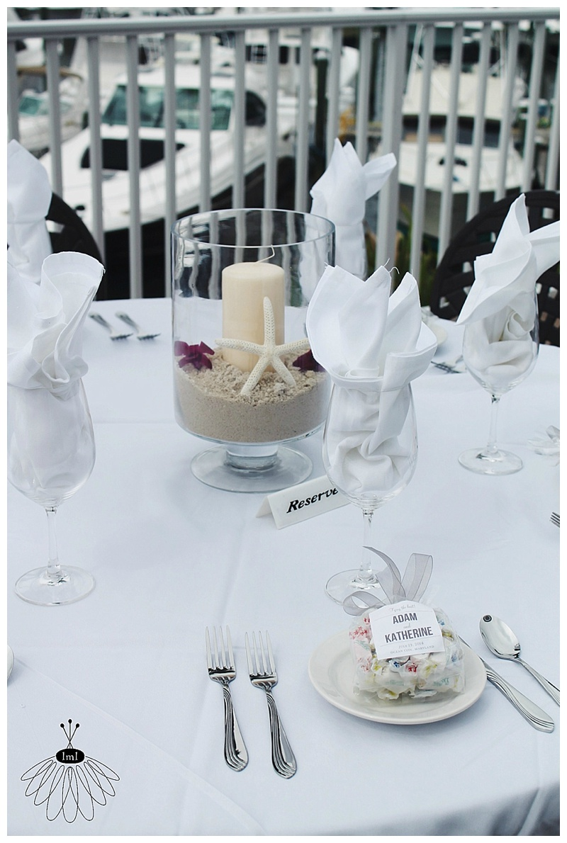 little miss lovely // ocean city md wedding florist // candle sand starfish orchid centerpiece