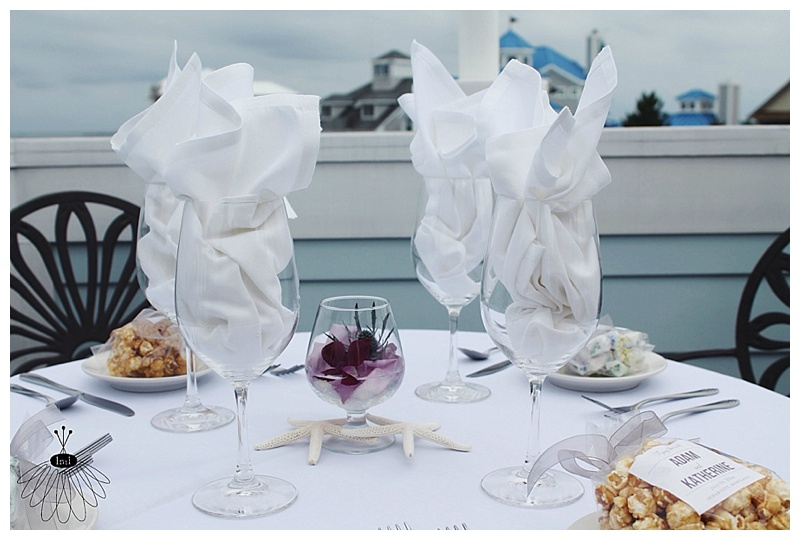 little miss lovely // ocean city md wedding florist // snifter glass cocktail table centerpieces with starfish and orchids
