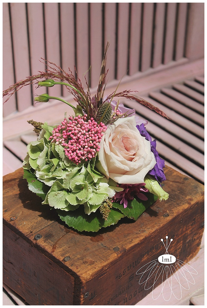 little miss lovely // ocean city md wedding florist // wedding cake flower topper // lily pads pheasant feathers