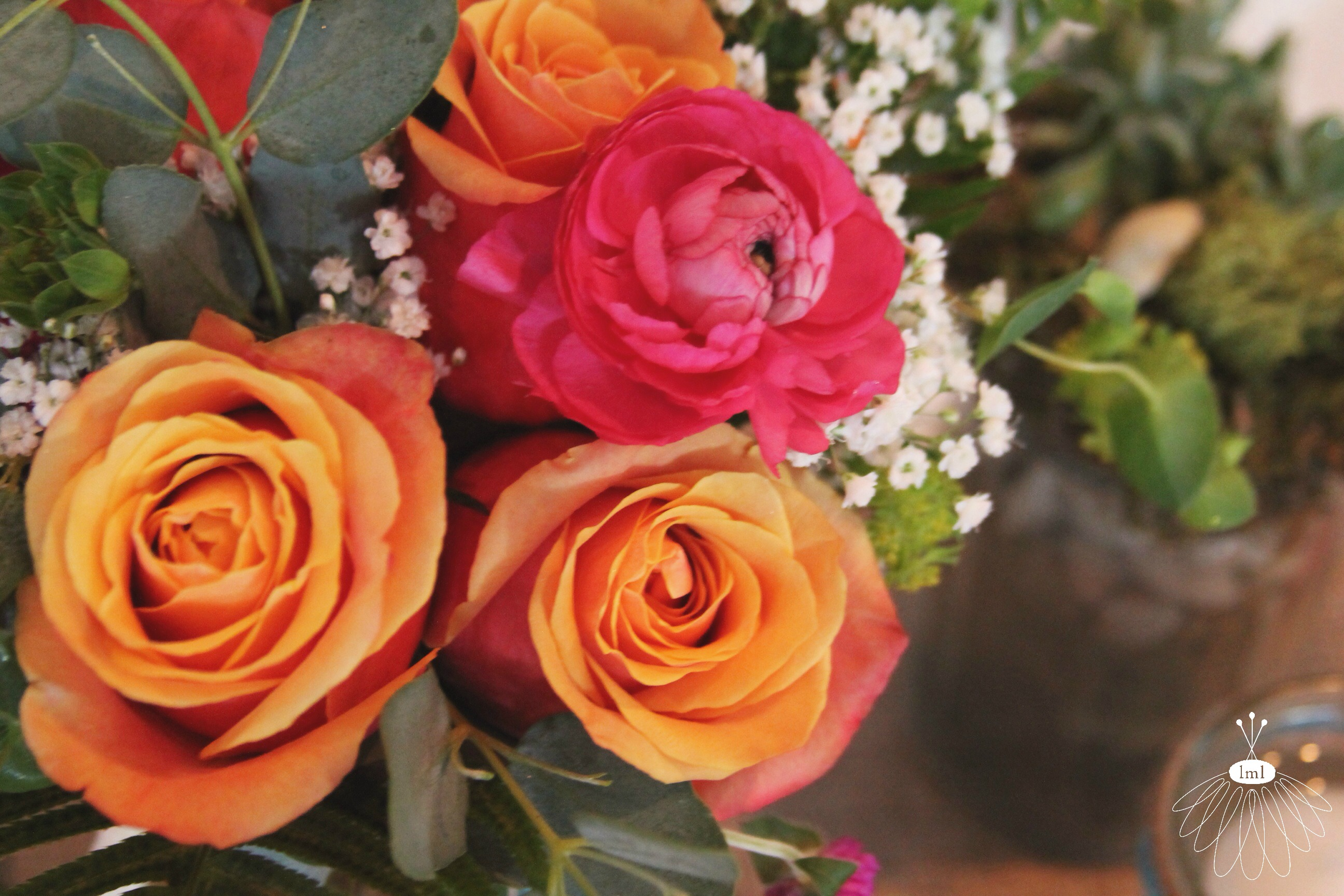 little miss lovely // orange roses and pink ranunculus