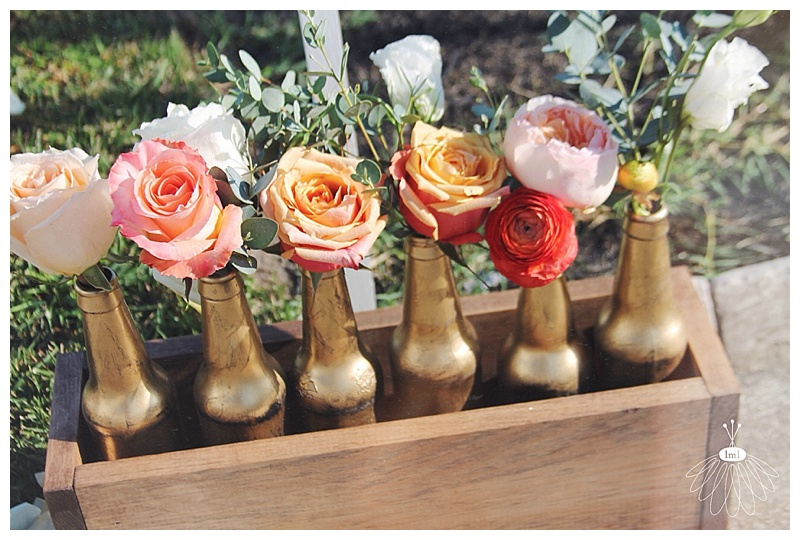 little miss lovely // wooden box of gold beer bottle wedding centerpiece