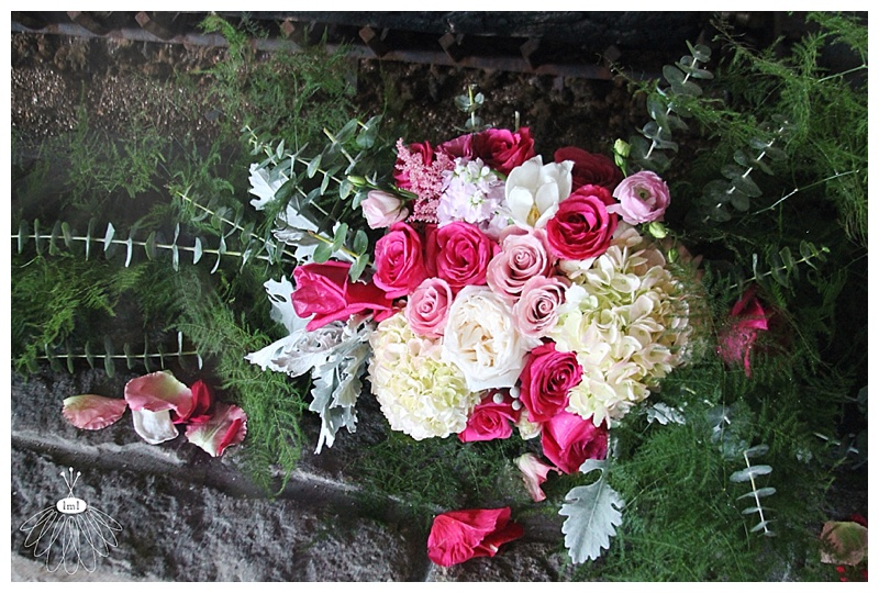 little miss lovely // lighthouse sound wedding reception fireplace mantle flower arrangement