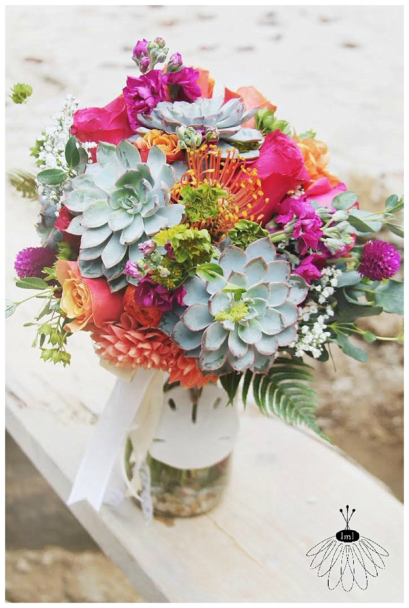 little miss lovely succulent bouquet with sand dollar
