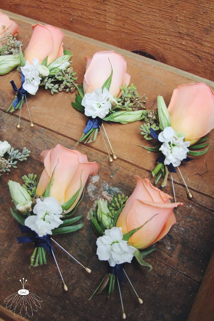 little miss lovely // peach rose coral and navy wedding boutonniere