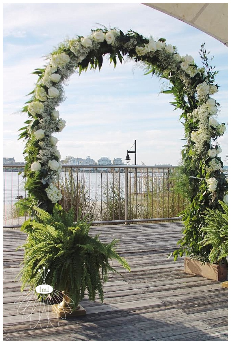 little miss lovely // ocean city wedding florist // hydrangea rose archway