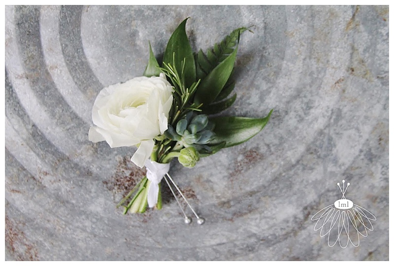 little miss lovely // ocean city wedding florist white ranunculus boutonniere with succulent