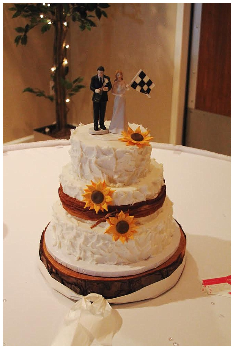 wedding cake with racing flag topper