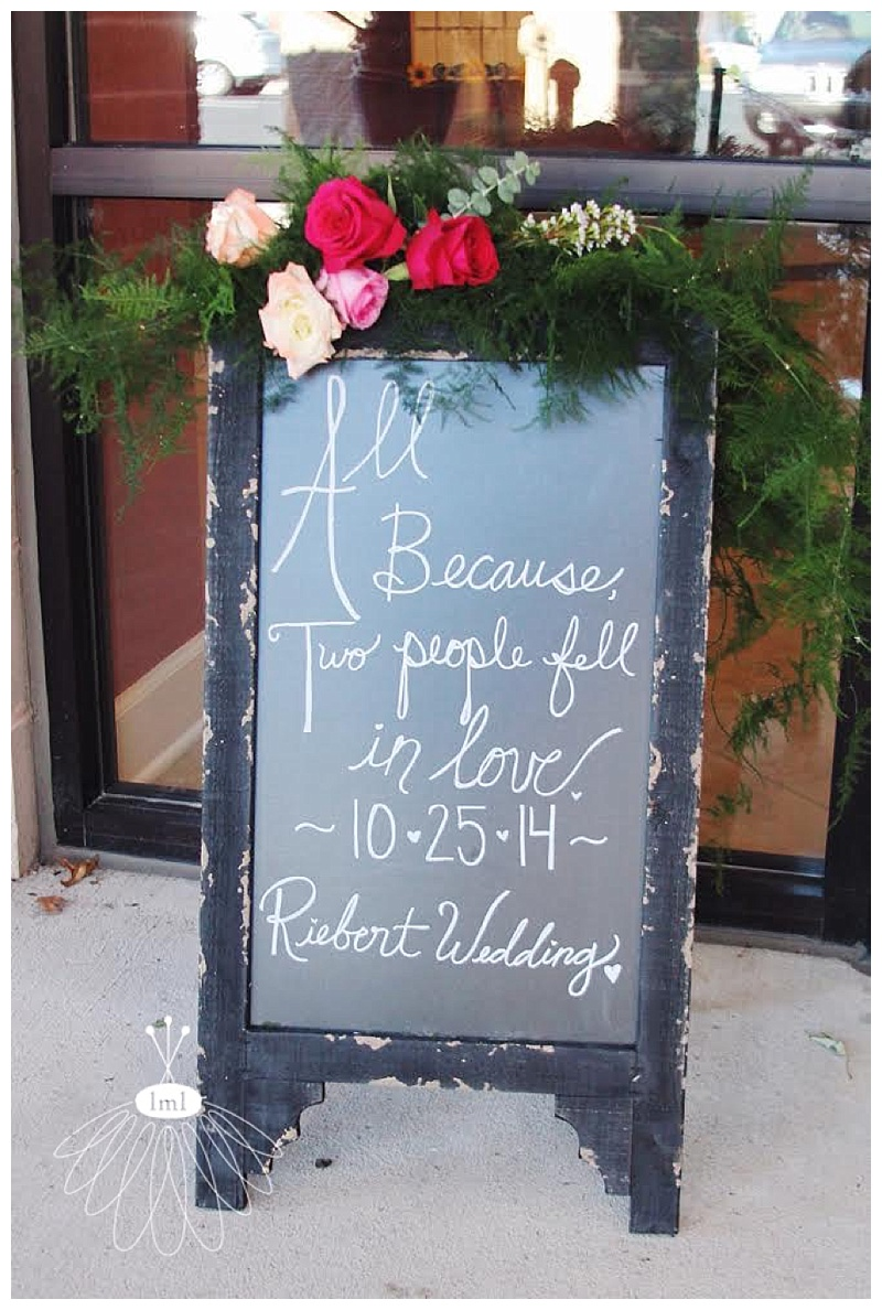 chalkboard with garland and pink roses // little miss lovely // berlin maryland wedding florist