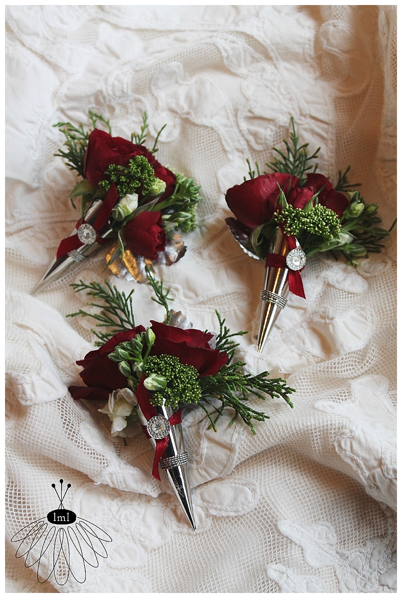little miss lovely // berlin md wedding florist // red rose and tulip winter wedding pin corsage