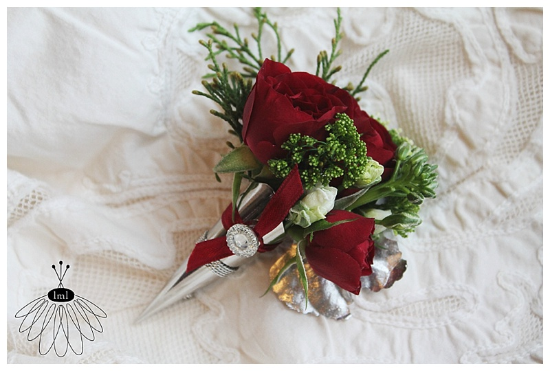 little miss lovely // berlin maryland wedding florist // red holiday wedding boutonniere in silver cone