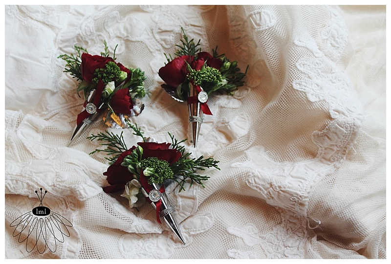 little miss lovely // berlin maryland wedding florist // red holiday wedding boutonnieres in silver cone