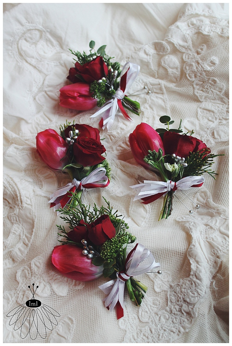 little miss lovely // berlin md wedding florist // red rose and tulip winter wedding pin corsages