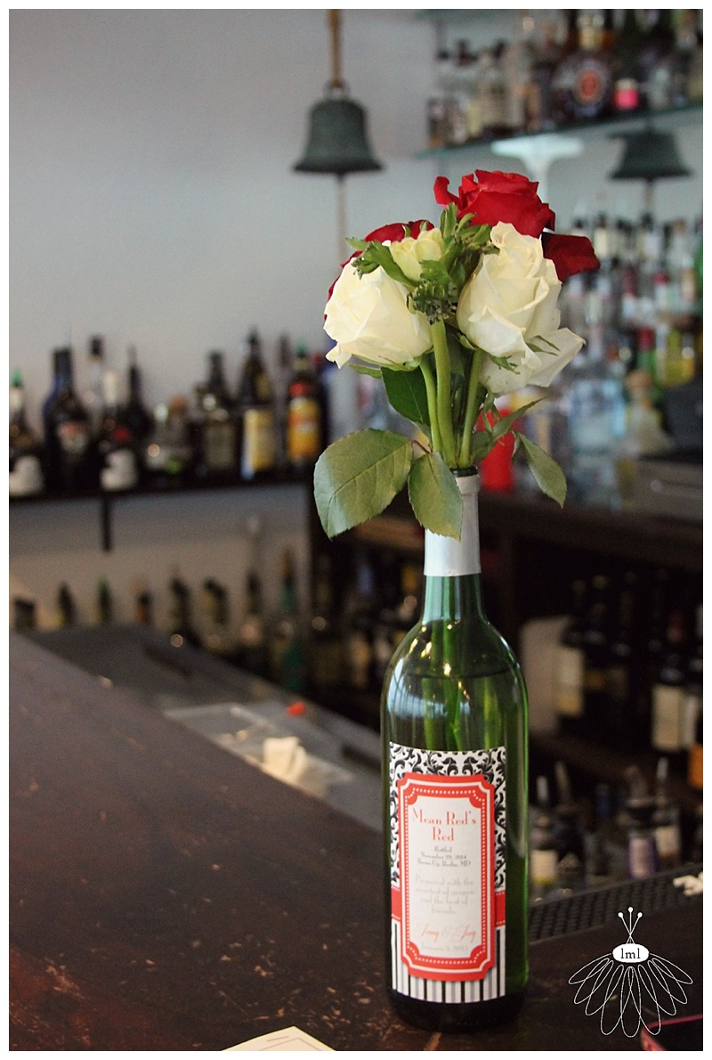 little miss lovely floral design // fagers island wedding // wine bottle floral centerpieces