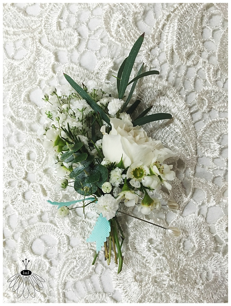 little miss lovely floral design // ocean city maryland // white rose babys breath greenery boutonniere