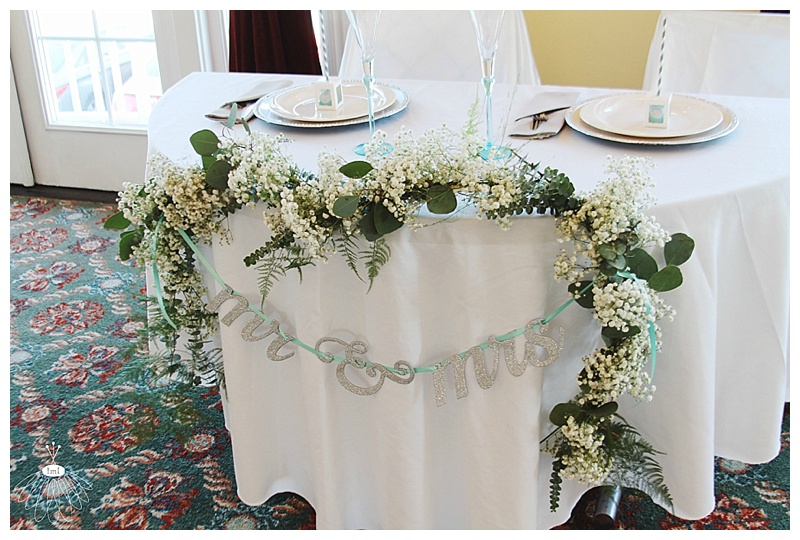 little miss lovely floral design // babys breath eucalyptus garland sweetheart table // mrs and mrs sign // coconut malorie wedding