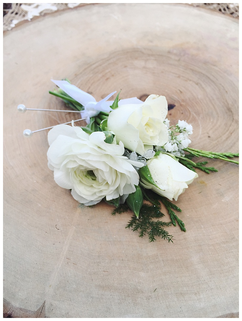 little miss lovely floral design // ocean city maryland wedding florist // white boutonniere with ranunculus