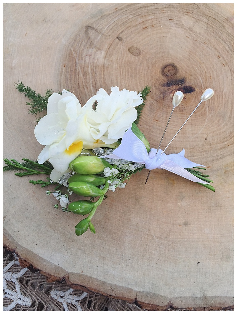 little miss lovely floral design // white freesia groom boutonniere