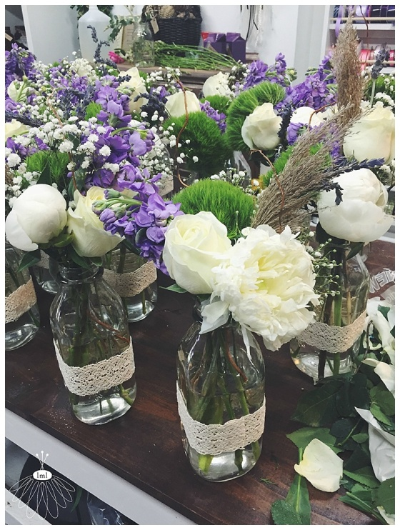 little miss lovely // ocean city maryland wedding florist // purple and white beach wedding // white and lavender vintage bottle centerpieces