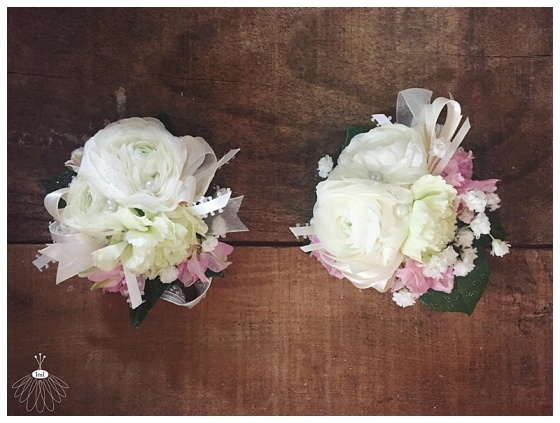 little miss lovely floral design // white ranunculus wrist corsage for mother of the bride