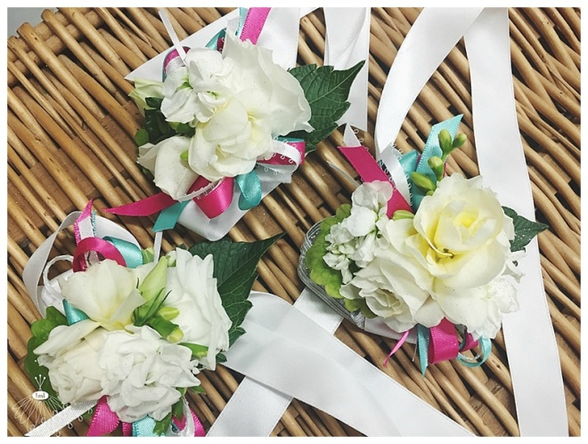 little miss lovely floral design // white freesia and spray rose wrist corsage