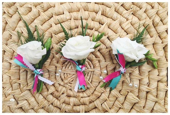 little miss lovely floral design // white lisianthis boutonniere with pink and teal accents