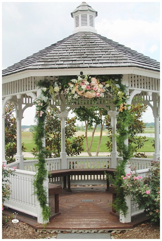 little miss lovely floral design // gazebo with garland and floral spray // wedding flowers at heritage shores
