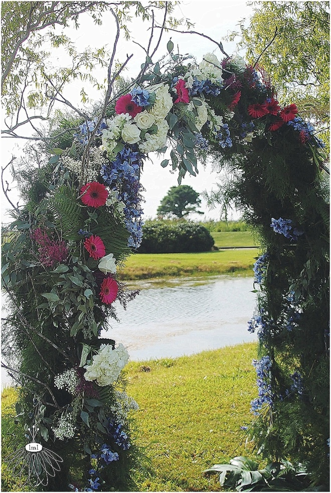 little miss lovely floral design // ocean city maryland wedding florist // gerber daisy and hydrangea archway