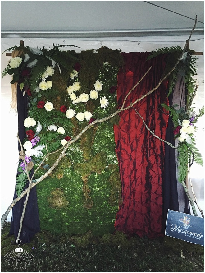 little miss lovely floral design // moss and curtain flower wall ceremony Photo Booth backdrop