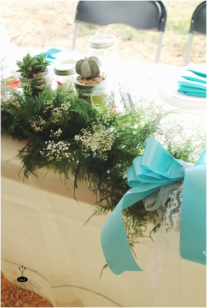 little miss lovely floral design // garland and bows with succulents on sweetheart table