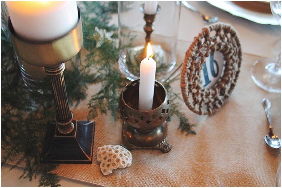 little miss lovely floral design // brass candles nautical fern babys breath centerpiece